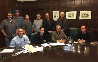 Finally, the cartoonists of the Chicago chapter of the NCS are promoted to a seat at the big table for the Fall 2017 chapter meeting on October 22 - the executive boardroom of the Chicago Tribune in the Tribune Tower in downtown Chicago. Seated in front row (l to r): Brian Diskin, Ryan Pagelow, Richard Pietrzyk, and Pat Byrnes. Standing behind them: Daniel Beyer (2017 chapter inductee), Bill King, Kenny Durkin, Bill Whitehead, Tribune editorial cartoonist Scott Stantis, and Jim McGreal. Invisible member seated in green chair: T. Brian Kelly.